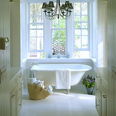 A claw foot tub, double hung windows, and lots of white. And lavender in a pot of course!